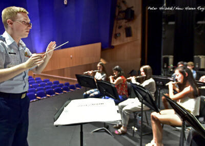 Guilford High School students rehearse for a side-by-side performance with the Coast Guard Band